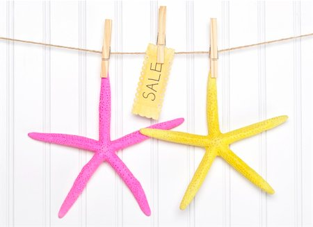 simsearch:400-04638538,k - Nautical Themed Sale Starfish with Sign on Clothesline on White. Stock Photo - Budget Royalty-Free & Subscription, Code: 400-06081029