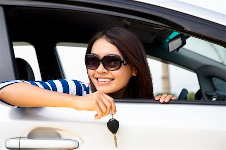 young woman holding key in car Stock Photo - Budget Royalty-Free & Subscription, Code: 400-06081641