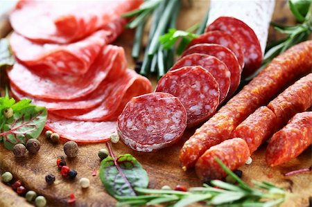 Different Italian ham and salami with herbs Stock Photo - Budget Royalty-Free & Subscription, Code: 400-06082976