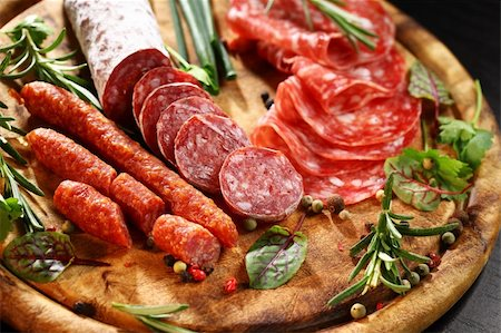 Different Italian ham and salami with herbs Stock Photo - Budget Royalty-Free & Subscription, Code: 400-06082979