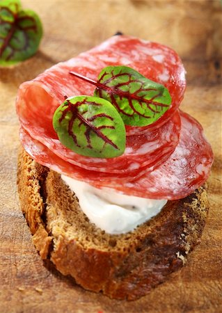Canape with cream cheese, salami and herbs Stock Photo - Budget Royalty-Free & Subscription, Code: 400-06082980