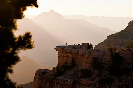Image of a lone person looking out over an early mornig view of the Grand Canyon Stock Photo - Budget Royalty-Free & Subscription, Code: 400-06094774