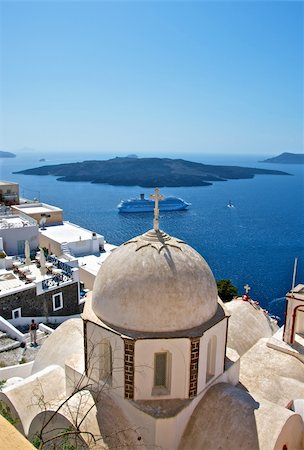 In the foreground is seen a white church steeple with a cross. He towers over the city. At the bottom of the waters of the Mediterranean Sea can be seen an old volcano. Stock Photo - Budget Royalty-Free & Subscription, Code: 400-06095112