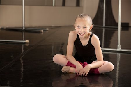 Cute young ballerina sitting on a dance floor Stock Photo - Budget Royalty-Free & Subscription, Code: 400-06097047