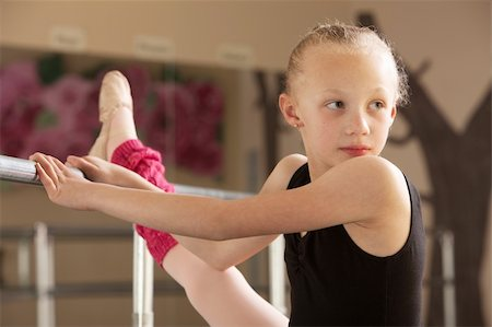 Serious child ballet student looks over her shoulder Stock Photo - Budget Royalty-Free & Subscription, Code: 400-06097050