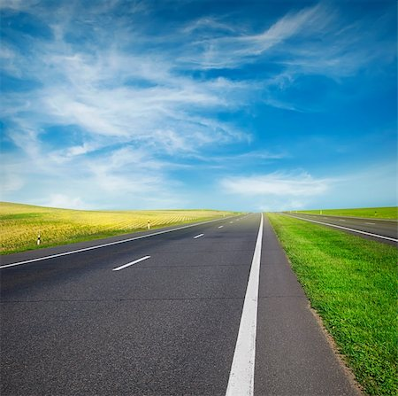 road landscape - green field and road over blue sky Stock Photo - Budget Royalty-Free & Subscription, Code: 400-06099337