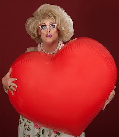 Shocked drag queen with heart shaped balloon Stock Photo - Budget Royalty-Free & Subscription, Code: 400-06090221