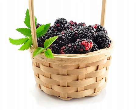 blackberries in a basket on white background Stock Photo - Budget Royalty-Free & Subscription, Code: 400-06090663