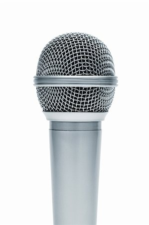 Beautiful new microphone on a white background Stock Photo - Budget Royalty-Free & Subscription, Code: 400-06093848
