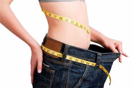 Woman seen how much weight she lost. Isolated background. Stock Photo - Budget Royalty-Free & Subscription, Code: 400-06104060
