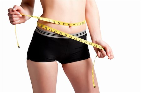 Woman measuring her waist with a yellow measuring tape Stock Photo - Budget Royalty-Free & Subscription, Code: 400-06104063