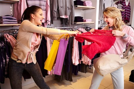pressmaster - Image of two greedy girls fighting for red tanktop in department store Stock Photo - Budget Royalty-Free & Subscription, Code: 400-06104204