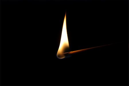 Burning match on black background Stock Photo - Budget Royalty-Free & Subscription, Code: 400-06105606