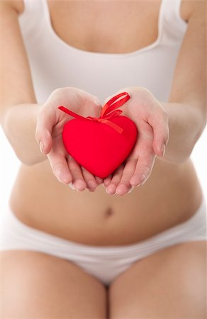 Healthy woman holding heart in hands on white Stock Photo - Budget Royalty-Free & Subscription, Code: 400-06105640