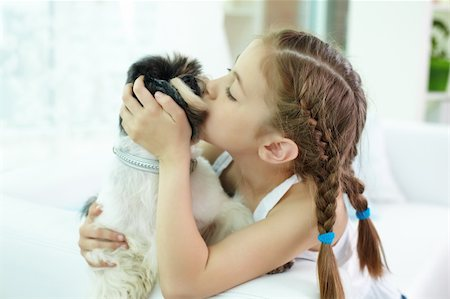 dog kissing girl - Portrait of happy girl kissing shih-tzu dog at home Stock Photo - Budget Royalty-Free & Subscription, Code: 400-06107089