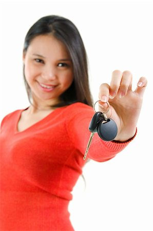 Happy Asian woman showing her new car key, isolated on white, focus on car key Stock Photo - Budget Royalty-Free & Subscription, Code: 400-06107322