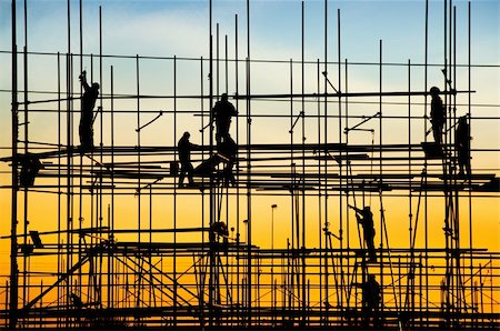 Construction site, silhouettes of workers against the light/ Stock Photo - Budget Royalty-Free & Subscription, Code: 400-06107602