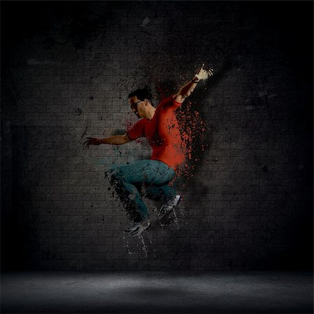 splat - Abstract grunge man dancing against a dark brick wall Stock Photo - Budget Royalty-Free & Subscription, Code: 400-06107660
