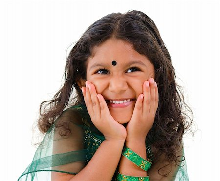 Young little Asian Indian girl smiling on white background Stock Photo - Budget Royalty-Free & Subscription, Code: 400-06108514