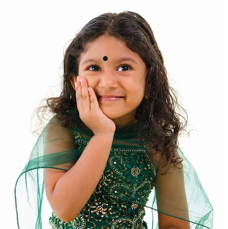 Thoughtful little Indian girl hand on chin , isolated white background Stock Photo - Budget Royalty-Free & Subscription, Code: 400-06108513