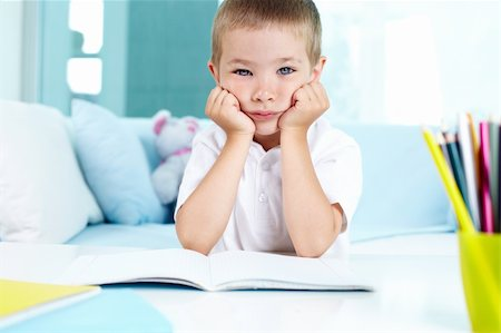 Kid not feeling like doing his homework Stock Photo - Budget Royalty-Free & Subscription, Code: 400-06109364