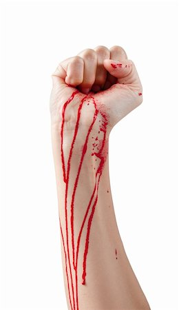 A red paint soaked hand making a fist isolated on white. Stock Photo - Budget Royalty-Free & Subscription, Code: 400-06101541