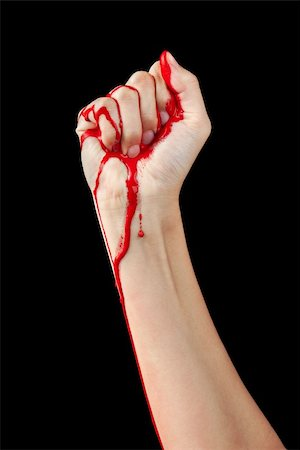 A red paint soaked hand making a fist isolated on black. Stock Photo - Budget Royalty-Free & Subscription, Code: 400-06101542