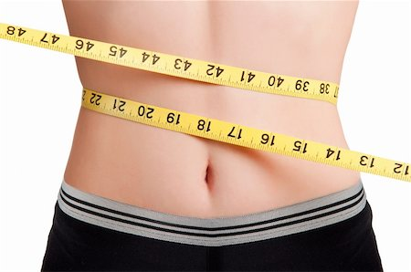 Woman measuring her waist with a yellow measuring tape Stock Photo - Budget Royalty-Free & Subscription, Code: 400-06101974