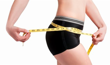 Woman measuring her waist with a yellow measuring tape Stock Photo - Budget Royalty-Free & Subscription, Code: 400-06101975