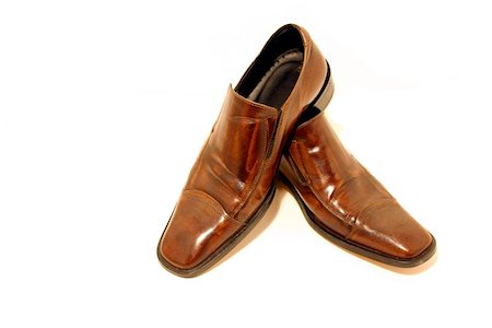 Isolated picture of a pair of Brown Shoes Stock Photo - Budget Royalty-Free & Subscription, Code: 400-06126606