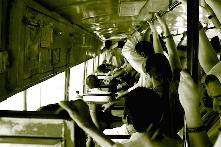 A crowded Delhi Transport Corporation Bus in New Delhi, India. The DTC buses, which run on Compressed Natural Gas are the back bone of Delhi. Stock Photo - Budget Royalty-Free & Subscription, Code: 400-06129190