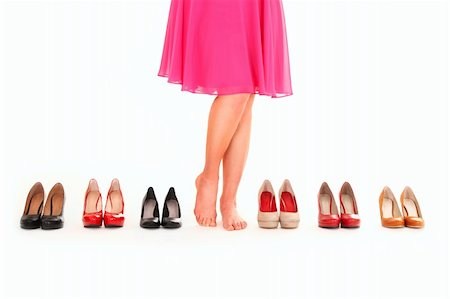 foot model - A picture of sexy female legs among six pairs of shoes over white background Stock Photo - Budget Royalty-Free & Subscription, Code: 400-06135514