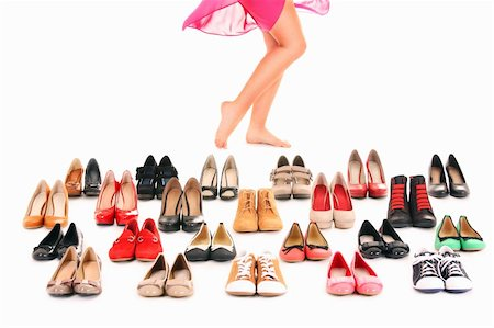 foot model - A picture of sexy female legs among shoes over white background Stock Photo - Budget Royalty-Free & Subscription, Code: 400-06135517