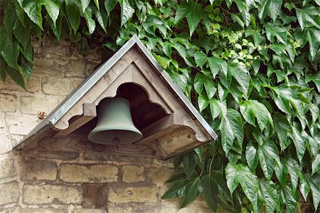 Bell of an old monastery and the wall covered with ivy Stock Photo - Budget Royalty-Free & Subscription, Code: 400-06135773