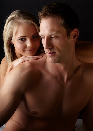 female nude sex - Young and fit caucasian adult couple in an embrace. Semi-nude and topless against a dark background . Stock Photo - Budget Royalty-Free & Subscription, Code: 400-06137144