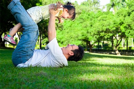 family fun day background - happy father and little girl on the grass Stock Photo - Budget Royalty-Free & Subscription, Code: 400-06137751