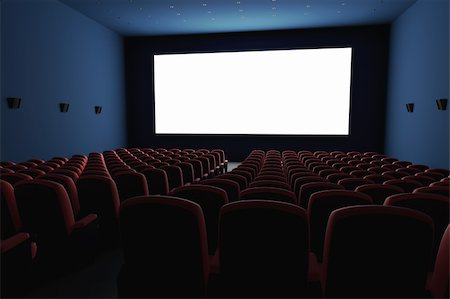 Inside of the cinema. Several empty seats waiting the movie on the white screen. Your text or picture on the white screen. Stock Photo - Budget Royalty-Free & Subscription, Code: 400-06137877