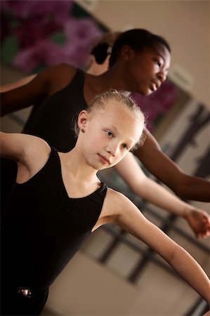 Two young ballet students concentrate in class Stock Photo - Budget Royalty-Free & Subscription, Code: 400-06138340
