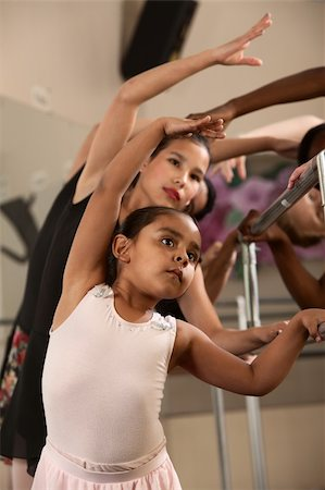 Ballet students stretch out and warm up Stock Photo - Budget Royalty-Free & Subscription, Code: 400-06138342