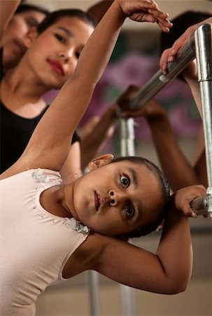 Cute children on railing practice during ballet class Stock Photo - Budget Royalty-Free & Subscription, Code: 400-06138343