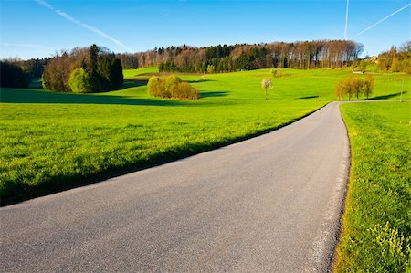 road landscape - Asphalt Road Leading to the Farmhouse in the Swiss Alps Stock Photo - Budget Royalty-Free & Subscription, Code: 400-06138593