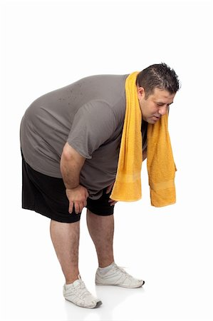 fat man exercising - Fat man playing sport isolated on a white background Stock Photo - Budget Royalty-Free & Subscription, Code: 400-06139999