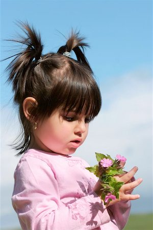 Little girl with pigtails holding a handful of pink wild flowers. Stock Photo - Budget Royalty-Free & Subscription, Code: 400-06131714