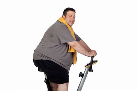 fat man exercising - Fat man playing sport isolated on a white background Stock Photo - Budget Royalty-Free & Subscription, Code: 400-06140006
