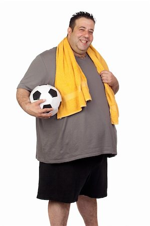 fat man exercising - Fat man with a soccer ball isolated on a white background Stock Photo - Budget Royalty-Free & Subscription, Code: 400-06140001