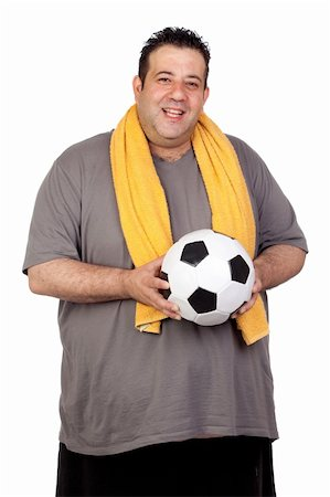 fat man balls - Fat man with a soccer ball isolated on a white background Stock Photo - Budget Royalty-Free & Subscription, Code: 400-06140002