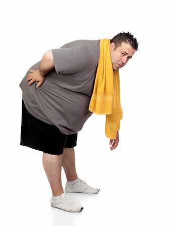 fat man exercising - Fat man playing sport isolated on a white background Stock Photo - Budget Royalty-Free & Subscription, Code: 400-06140003
