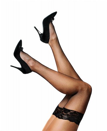 stocking feet - Sexy female legs in net stockings isolated over white Stock Photo - Budget Royalty-Free & Subscription, Code: 400-06140432