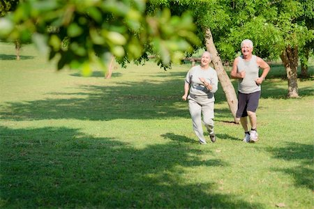 diego_cervo (artist) - Active retirement, senior couple running and exercising in city park. Copy space Stock Photo - Budget Royalty-Free & Subscription, Code: 400-06140800