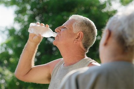 diego_cervo (artist) - Senior people, old man and woman talking and drinking water after exercising in park Stock Photo - Budget Royalty-Free & Subscription, Code: 400-06140801